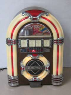Crosley Table Top Lighted Juke Box With AM FM Radio & Cassette Player