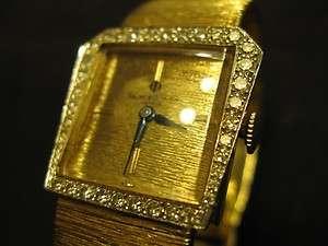 VINTAGE BAUME + MERCIER 14K YELLOW GOLD + DIAMOND BEZEL WRIST WATCH